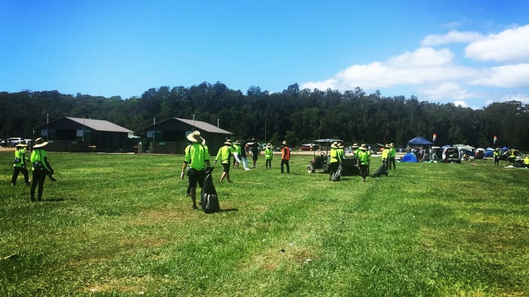 Cleaning crews going through the Falls Festival campgrounds at Byron Bay after campers left.