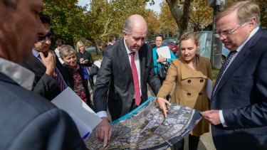 Planning Minister Richard Wynne examines maps of Fishermans Bend.