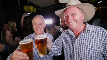 Prime Minister Malcolm Turnbull celebrates with the newly re-elected Barnaby Joyce in Tamworth.