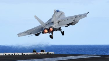 An F/A-18F Super Hornet takes off from the USS Ronald Reagan in the Coral Sea off during the Talisman Sabre military exercise in July.