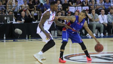 Adelaide's star point guard, import Jerome Randle is guarded closely Bullets import and MVP candidate Torrey Craig on Thursday night.