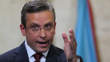Governor Alejandro Garcia Padilla said he would seek to work out a deal with creditors while urging Washington to pass a law allowing the island to enter a special form of bankruptcy and discharge some of its debts.