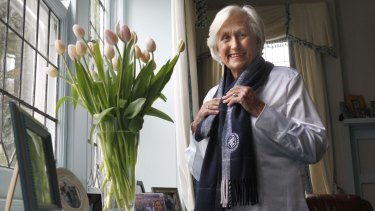 Vivienne Kerr with the flowers sent to her by Eddie Mcguire after Carlton's win over Collingwood in 2008.