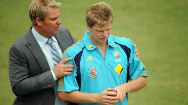 A word from the wise: Shane Warne gets in Steve Smith's ear before play on the second day of the Boxing Day Test against Pakistan in 2009.