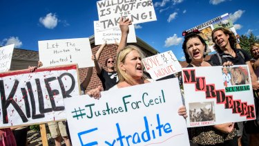 Kristen Hall leads a group of protesters  in front of Walter Palmer's dental practice in Bloomington, Minnesota.