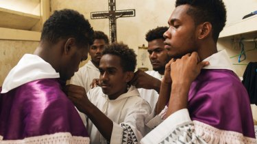Altar boys at Holy Cross Cathedral in Honiara prepare for a service.