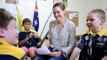 Dr Jess Baker, with kids in a focus group on dementia