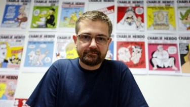No stranger to controversy ... Charlie Hebdo's publisher, Stephane Charbonnier, in 2012. A 24-year-old man faced trial for allegedly threatening to behead Charbonnier in June, 2013.