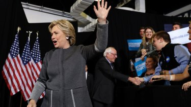 Hillary Clinton and Senator Bernie Sanders arrive for a panel discussion at the University Of New Hampshire.