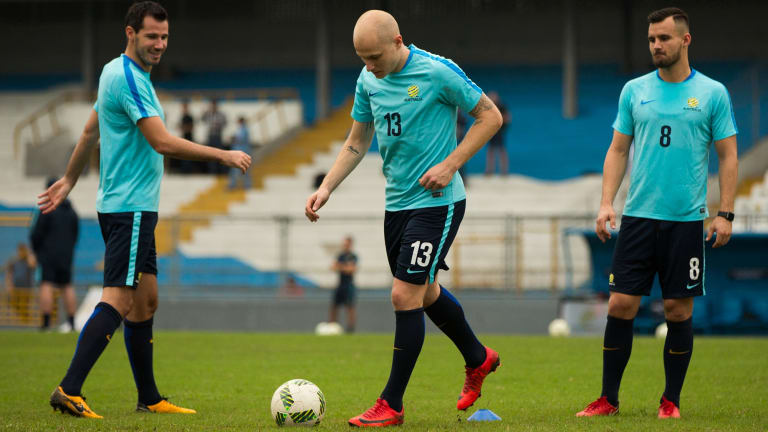 Aussies on tour: Aaron Mooy and Bailey Wright both ply their trade in England, while Ryan McGowan (left) plays in the UAE.