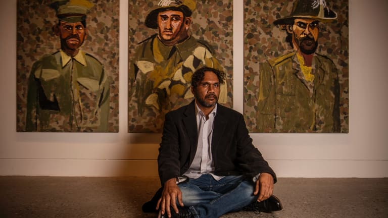 Vincent Namatjira, at Hazelhurst Arts Centre with part of his new work for the exhibition.