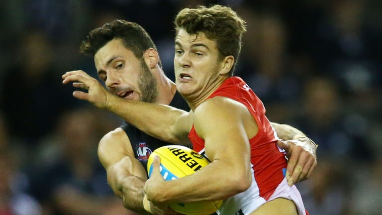 New talent: Tom Papley is tackled during Sydney's match against Carlton at Etihad Stadium on Saturday.