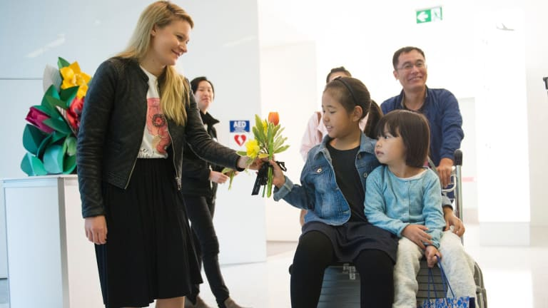 The first customers to disembark from the Capital Express were greeted with flowers