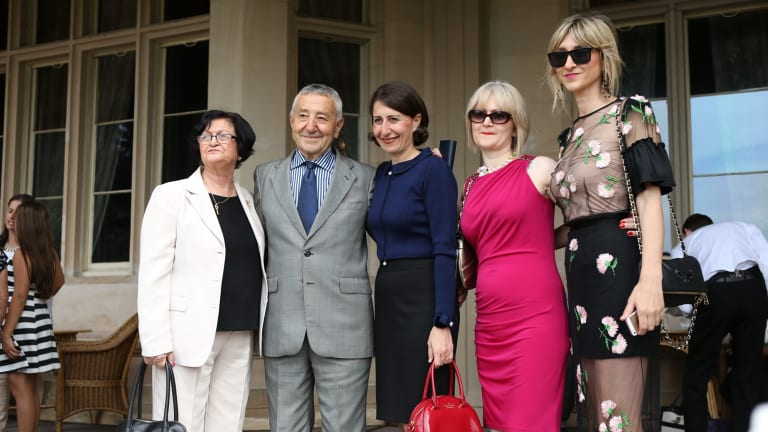 Glady Berejiklian with her parents and sisters after being sworn in as the first female Treasurer in NSW.
