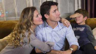 Xavier Trudeau, right, covers his eyes as his dad, Liberal leader Justin Trudeau watches the election results with his wife Sophie Gregoire on Monday.
