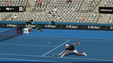 Plenty of good seats available:  James Duckworth plays a backhand in his match against Inigo Cervantes  during day three of the  Sydney International.