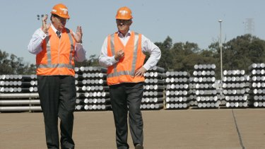 Unions have called for Malcolm Turnbull (right, at the Tomago smelter in 2009) to intervene.