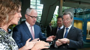 Prime Minister Malcolm Turnbull and Industry Minister Christopher Pyne visited CSIRO in December to launch their innovation policy,with CEO Larry Marshall in the background.