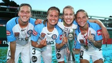 Jess Fishlock, right, celebrates City's latest triumph with her teammates.