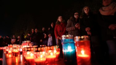 Bosnian Croat people, gather to light candles and pray for Slobodan Praljak, in southern Bosnian town of Mostar south of Sarajevo, on Wednesday.