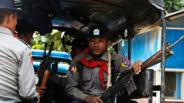 Myanmar police officers patrolling Maungdaw in Rakhine State, which neighbours  Bangladesh.