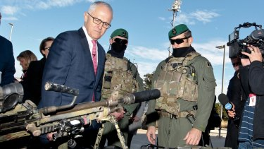 Prime Minister Malcolm Turnbull, pictured with Australian Defence Force personnel, will meet with state and territory premiers on Thursday to discuss new counter-terrorism offences.