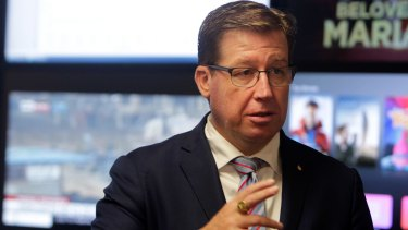 Police minister Troy Grant has been fined for using his phone behind the wheel of his car.
