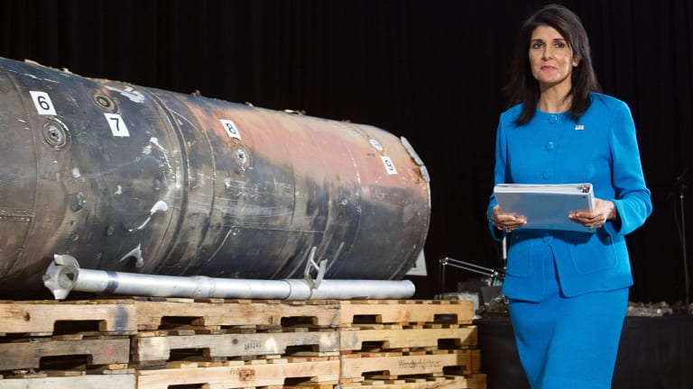 US Ambassador to the UN Nikki Haley walks past recovered remains of an Iranian rocket fired towards Saudi Arabia, during a press briefing last week.