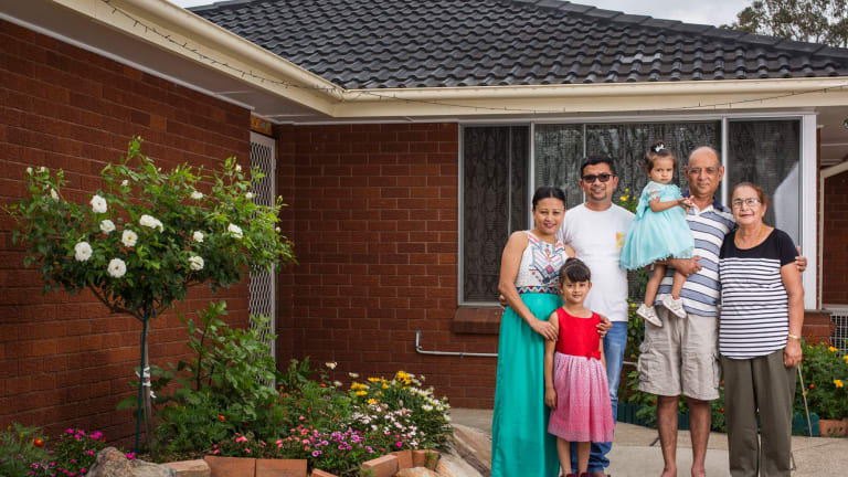 Three generations of the Chhetri family in their home in Marayong in Sydney, with the five adults paying the mortgage.  From left are Goma Khadka Chhetri, Sharon Chhetri (older daughter), Suman Chhetri, Shayana Chhetri (younger daughter), Nakul Chhetri and Dibyasori Chhetri.