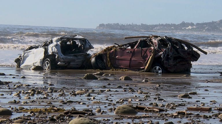 Mangled cars were swept all the way to the coast.