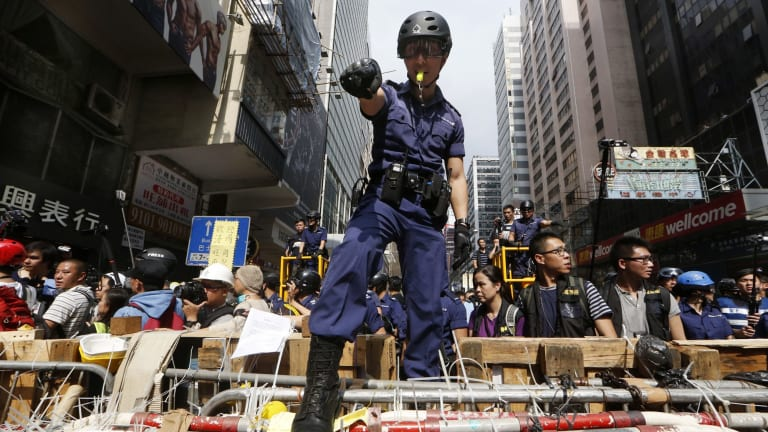 Police helped remove barricades at the Mong Kok protest site.