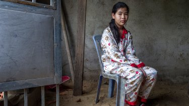 Ou Kung Panha, the daughter of jailed activist Tep Vanny inside their family home.