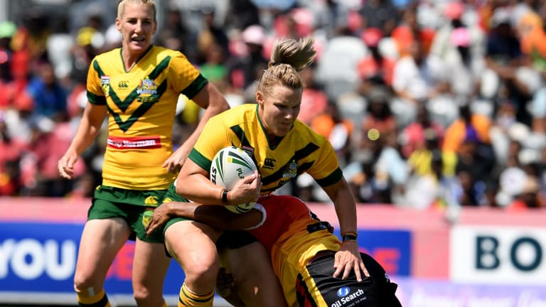 Strong run: Renae Kunst is tackled during Australia's dominant win over Papua New Guinea.