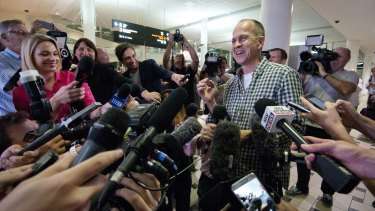 All smiles ... Peter Greste faces a huge media contingent after coming through Customs at Brisbane Airport following his release from prison in Cairo.