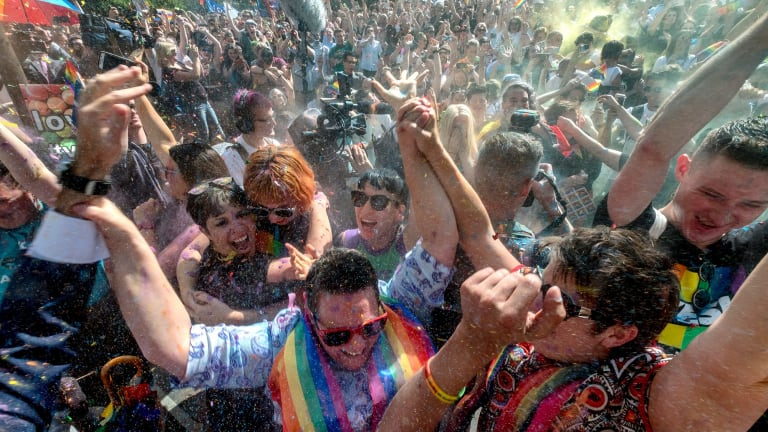 Melburnians celebrate as the marriage survey results are announced.