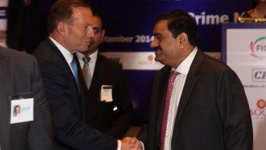Prime Minister Tony Abbott with mining magnate Gautam Adani in Delhi in 2014.