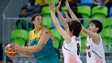 Australia centre Liz Cambage looks to pass around Japan forward Maki Takada (8) and forward Ramu Tokashiki.