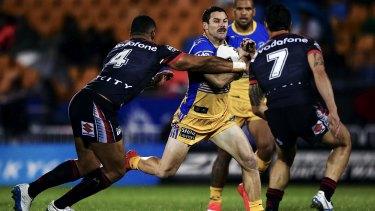 On the burst: Parramatta's Michael Gordon looks to get around David Fusitu'a of the Warriors.