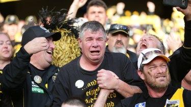Long-suffering Tiger faithful celebrate premiership glory.