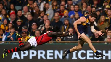 Dive bomber: Anthony McDonald-Tipungwuti stretches to tackle Patrick McGinnity, who kicked four goals for the Eagles.