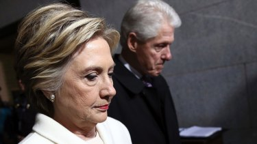 Facing up to failure: Hillary Clinton and her husband Bill arrive for the inauguration of US President Donald Trump in January.