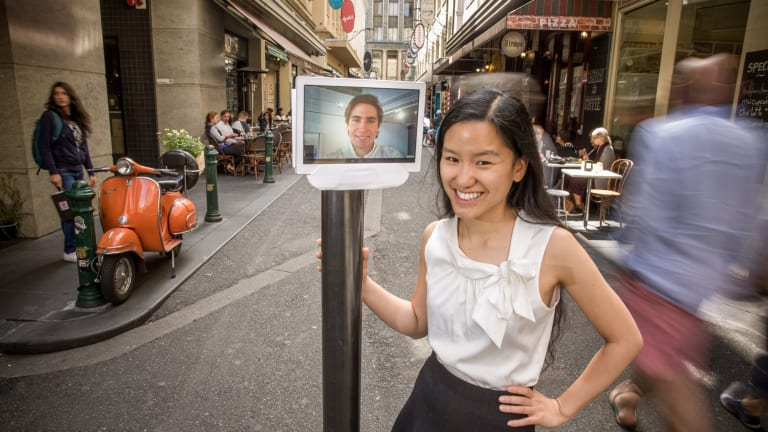 Virtual friends: Entrepreneur Marita Cheng with the robot likeness of fellow entrepreneur Alberto Rizzoli.