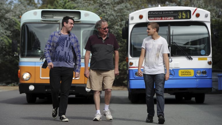 Heritage officer of the Retired ACT Transport Employees Club Todd Milton, club president Ian Baker and Watson-resident Kyle Threlfo with two buses that are being restored.