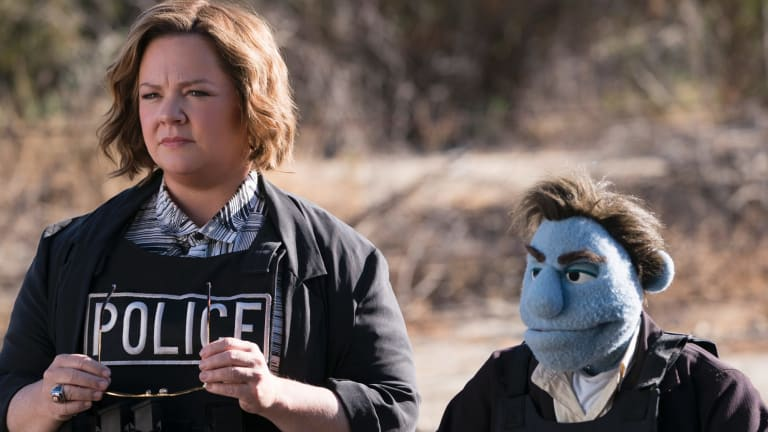 Melissa McCarthy struggles with her muppet co-star in The Happytime Murders.
