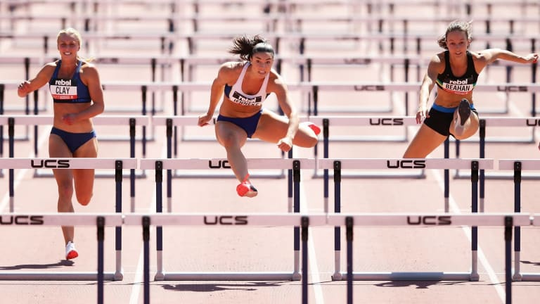 Olympian Michelle Jenneke returned to form in the 100m hurdles but just missed the world championships qualifier.