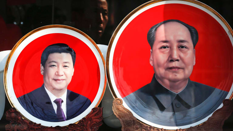"""""""It does harken back to Mao, this personality cult"""": souvenir plates bearing images of Chinese President Xi Jinping and Mao Zedong at a shop near Tiananmen Square in Beijing."""