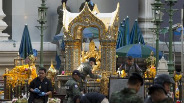 Police investigate the scene around the Erawan Shrine on Tuesday.