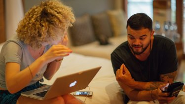 Guy Sebastian and British songwriter Fiona Bevan working on a song.