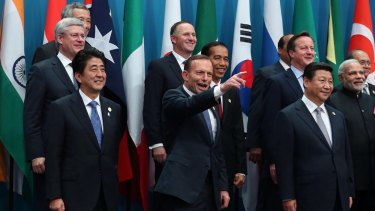 Prime Minister Tony Abbott poses with the G20 leaders for the family photo in Brisbane.