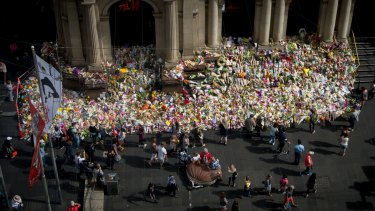 The tribute to victims of the Bourke Street rampage grows on the steps on the GPO.
